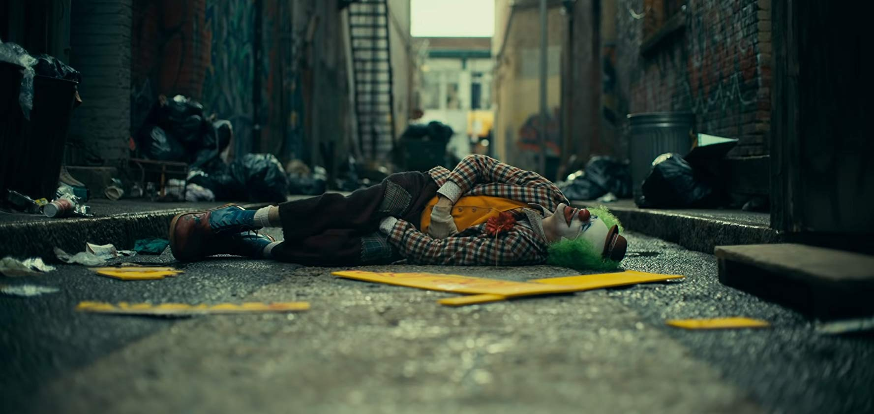 Joker laying down on Gotham streets